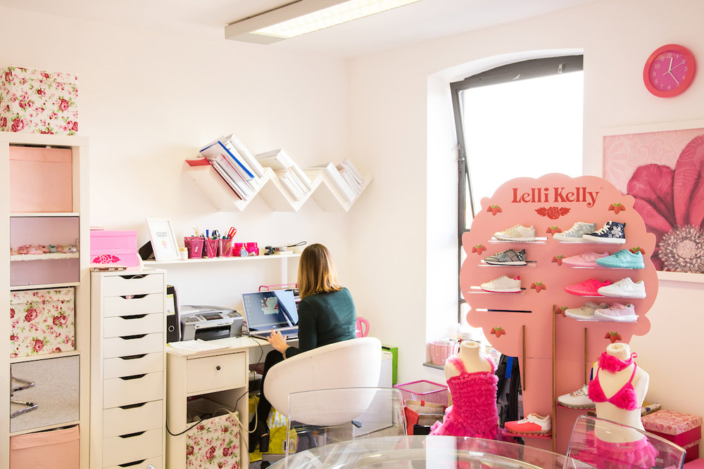 Office decorated in pink with shoes on display